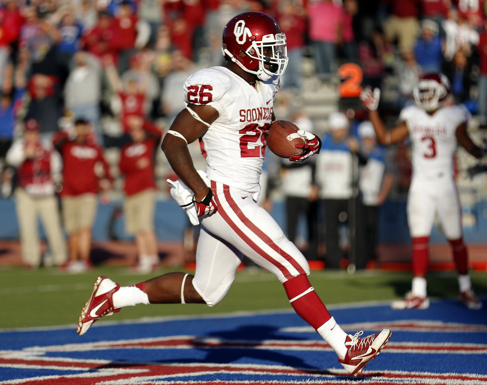 OU's Damien Williams (26) scores a touchdown in the fourth quarter during of the college football game between the University of Oklahoma Sooners (OU) and the University of Kansas Jayhawks (KU) at Memorial Stadium in Lawrence, Kan., Saturday, Oct. 19, 2013. OU won 34-19. Photo by Sarah Phipps, The Oklahoman