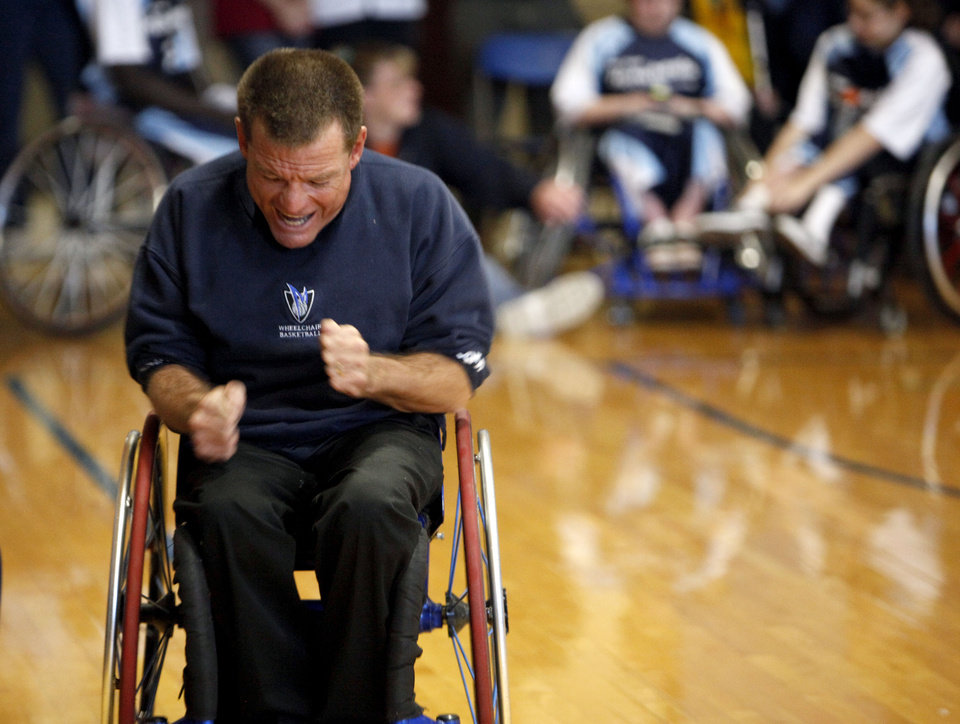 Dallas Junior Wheelchair Mavericks head coach JT Terry celebrates a score during the National Wheelchair Basketball Association's 2010 Southwest Conference, Saturday, Feb. 27, 2010, at the University of Central Oklahoma Wellness Center, in Edmond, Okla.  Photo by Sarah Phipps, The Oklahoman