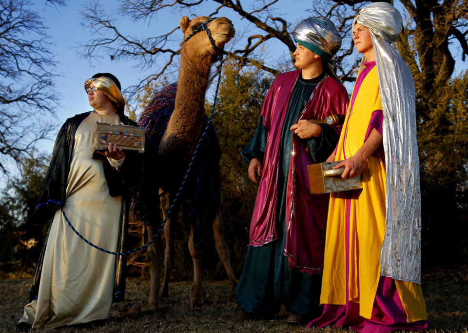 Photo - Gemini Samimi, 15, left, Justin Cox, 17, and Trent Henry, 16, pose for a photo in the Three Wise Men scene as part of the Boys Ranch Town annual drive-thru Christmas program. PHOTOS BY BRYAN TERRY, THE OKLAHOMAN