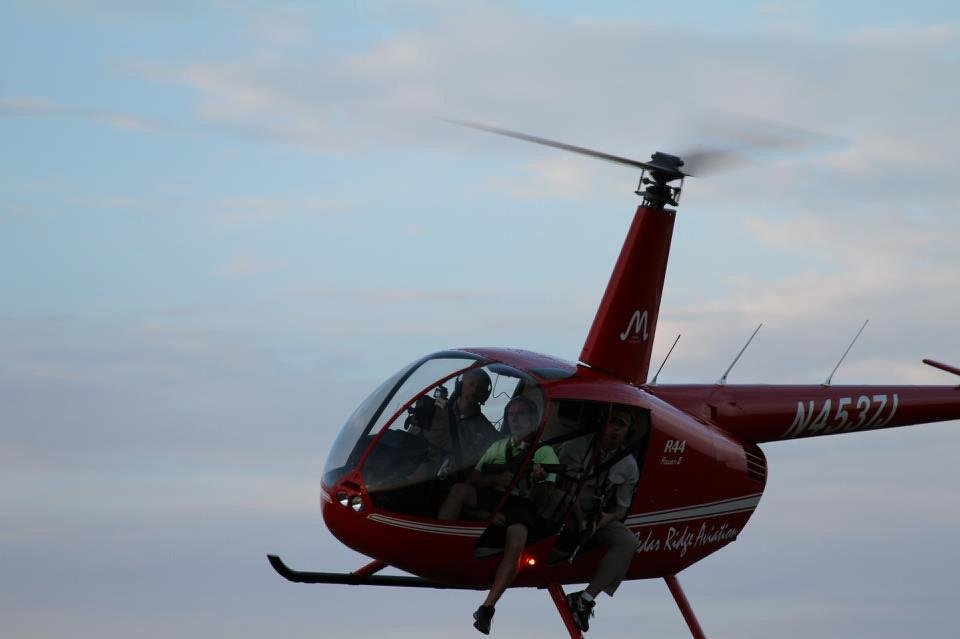 Photo - Helicopters are the way to hunt the wild hogs, said Dustin Johnson, owner-operator of Cedar Ridge Aviation. Under a new state law, Friday is the first day that the feral hogs can be hunted from the air Oklahoma. Photo provided