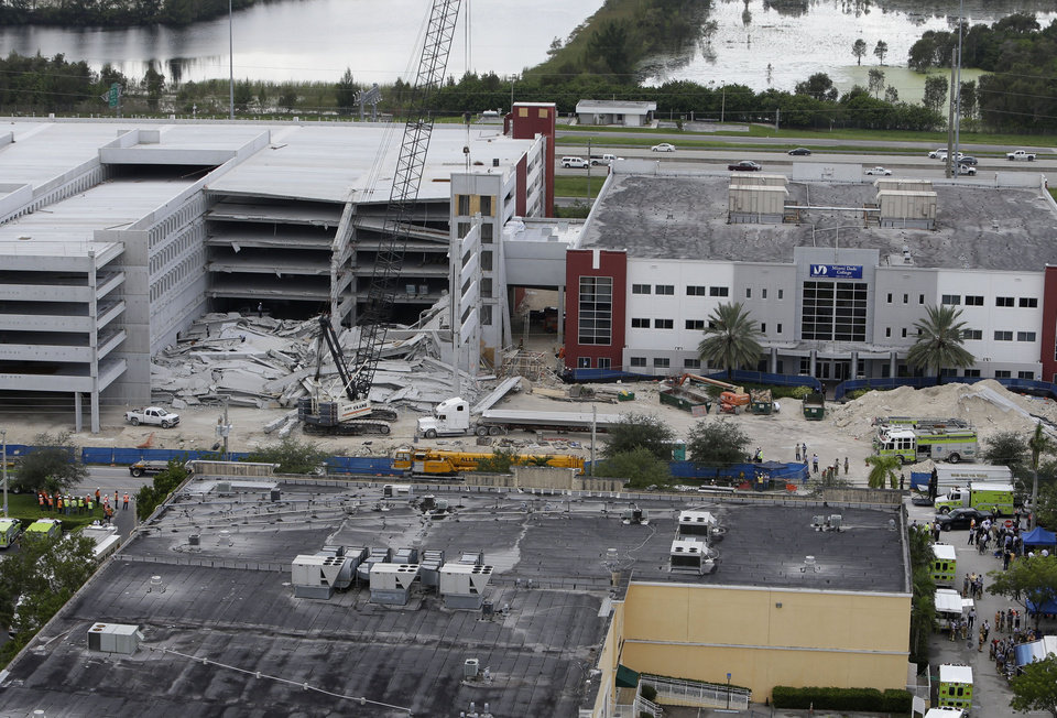 Photo -   A five-story parking garage is shown after it collapsed at Miami-Dade College, Wednesday, Oct. 10, 2012 in Miami, killing one worker and trapping two others in the rubble, officials said. Several other workers were hurt, including one rescued from the debris. (AP Photo/Lynne Sladky)