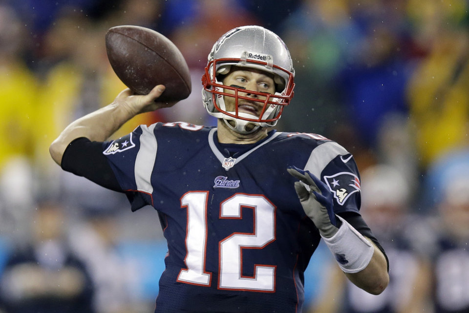 Photo - New England Patriots quarterback Tom Brady passes the ball during the second half of an AFC divisional NFL playoff football game against the Indianapolis Colts in Foxborough, Mass., Saturday, Jan. 11, 2014. (AP Photo/Stephan Savoia)