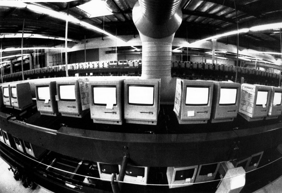 Photo - FILE - In this March 28, 1984, file photo, thousands of Apple Macintosh computers sit on double decked manufacturing lines. Friday, January 24, 2014, marks thirty years after the first Mac computer was introduced, sparking a revolution in computing and in publishing as people began creating fancy newsletters, brochures and other publications from their desktops. (AP Photo/Paul Sakuma, File)