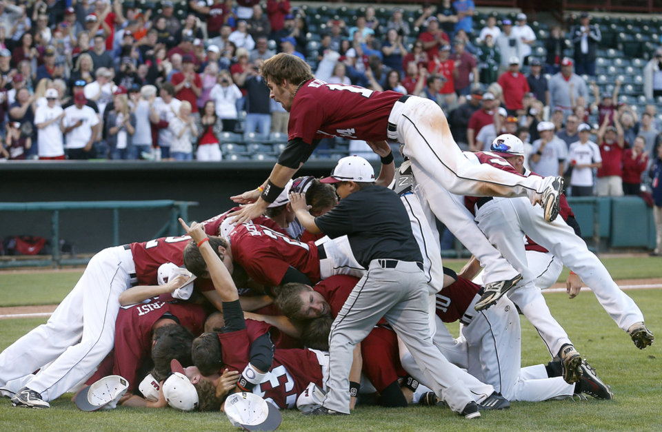 Photo - Tuttle celebrates their class 4A state baseball championship over Dewey at the Chickasaw Bricktown Ballpark in Oklahoma City, Saturday, May 17, 2014. Photo by Sarah Phipps, The Oklahoman