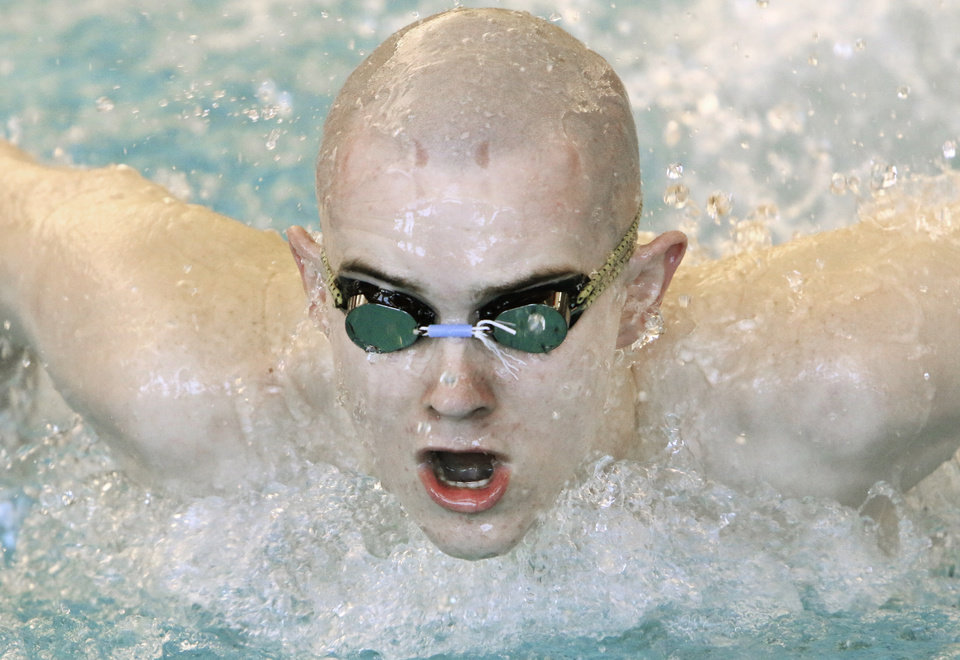 Photo - Stillwater's Charles Clark competes in the 100 yard butterfly during the Class 5A State Championships at the Edmond Aquatic Center, Friday February 21, 2014. Photo By Steve Gooch, The Oklahoman