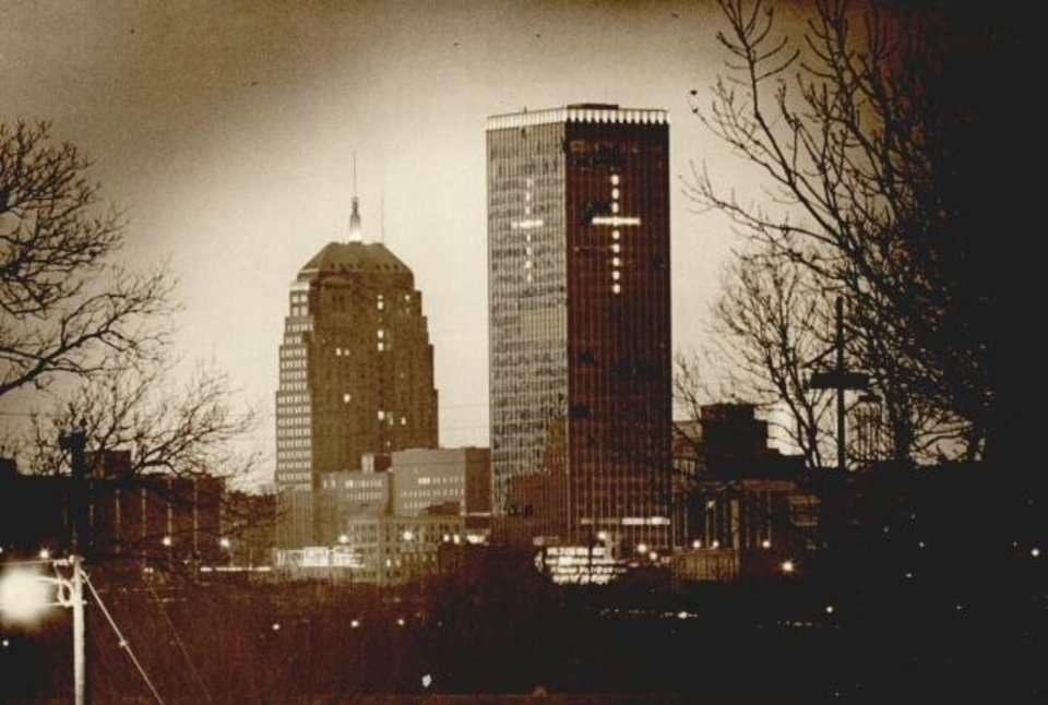 Photo -  The cross has glowed at what is now BancFirst Tower for more than 40 years as shown in this 1976 photo. The cross is missing this year as the tower is undergoing an extensive redevelopment. Oklahoman Archvies.