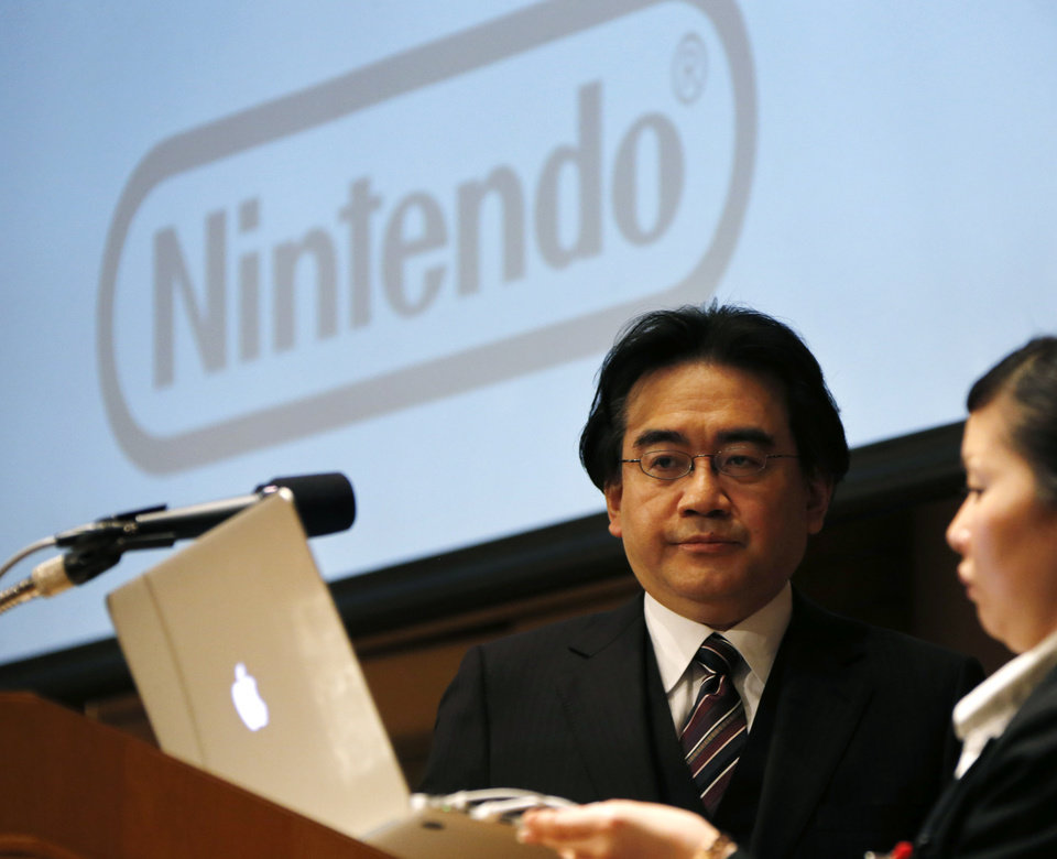 Photo - In this Thursday, Jan. 31, 2013 photo, Nintendo Co. President Satoru Iwata gets ready to speak during a news conference in Tokyo. As the yen weakens, famous Japanese exporters from Toyota to Nintendo are getting a boost but the favorable exchange rate also carries risks by insulating some companies from pressure to overhaul their businesses. Nintendo Co. raised its annual profit forecast through March 2013, to 14 billion yen ($154 million) from 6 billion yen ($66 million), largely because of the weak yen. (AP Photo/Koji Sasahara)