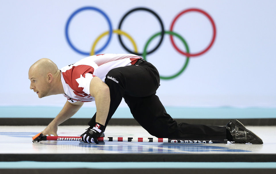 Photo - Canada's Ryan Fry watches the rock during the men's curling competition at the 2014 Winter Olympics, Monday, Feb. 10, 2014, in Sochi, Russia. (AP Photo/Wong Maye-E)