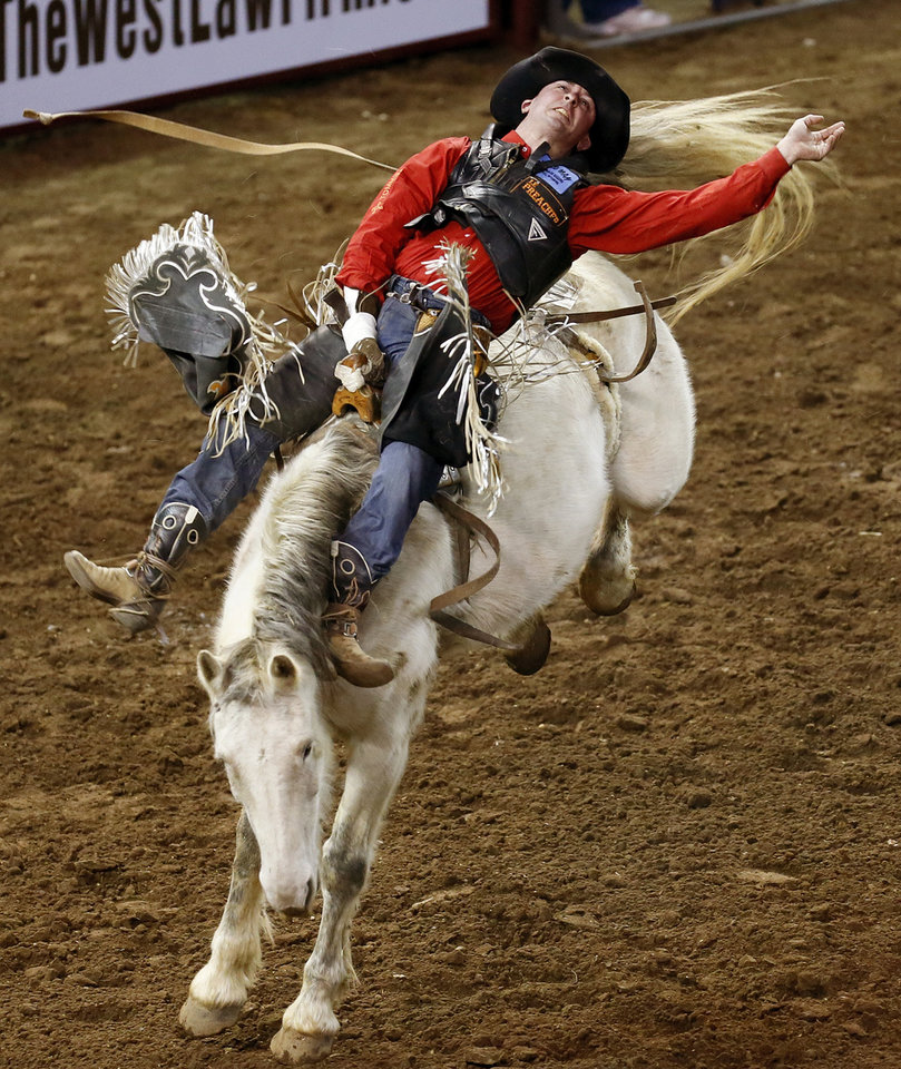 Shawn Minor of Camden, Ohio, competes in bareback bronc during the International Finals Rodeo (IFR 44) at the Jim Norick Arena at State Fair Park in Oklahoma City, Sunday, Jan. 19, 2014. Photo by Nate Billings, The Oklahoman