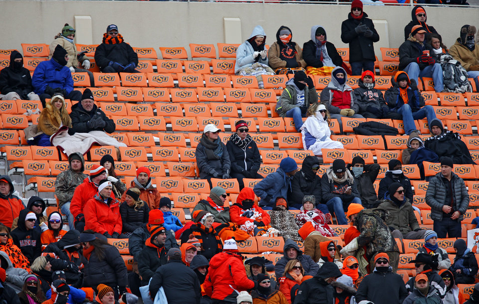 Photo - Empty sections of seats during the Bedlam college football game between the Oklahoma State University Cowboys (OSU) and the University of Oklahoma Sooners (OU) at Boone Pickens Stadium in Stillwater, Okla., Saturday, Dec. 7, 2013. Photo by Chris Landsberger, The Oklahoman
