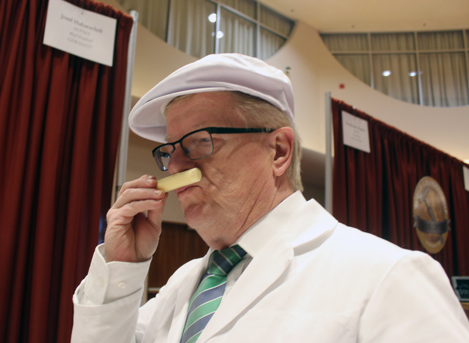 Photo - Contest judge Josef Hubatschek, from Germany, smells a cheese from the smear ripened semi soft category during the first day of judging for 2014 World Championship Cheese Contest Tuesday, March 18, 2014, in Madison, Wis. Entries in the 2014 World Championship Cheese Contest reached a new record this year, growing five percent to more than 2,600 entries from 22 nations around the world. (AP Photo/Carrie Antlfinger)