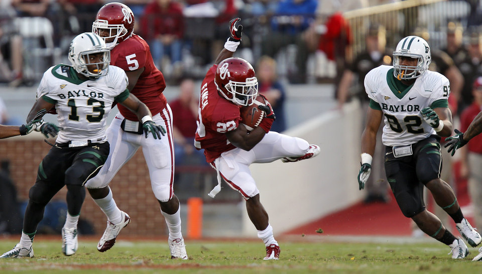 Photo - Oklahoma's Roy Finch (22) slips through a gap in the Baylor coverage on a kick return during the college football game between the University of Oklahoma Sooners (OU) and Baylor University Bears (BU) at Gaylord Family - Oklahoma Memorial Stadium on Saturday, Nov. 10, 2012, in Norman, Okla.  Photo by Chris Landsberger, The Oklahoman