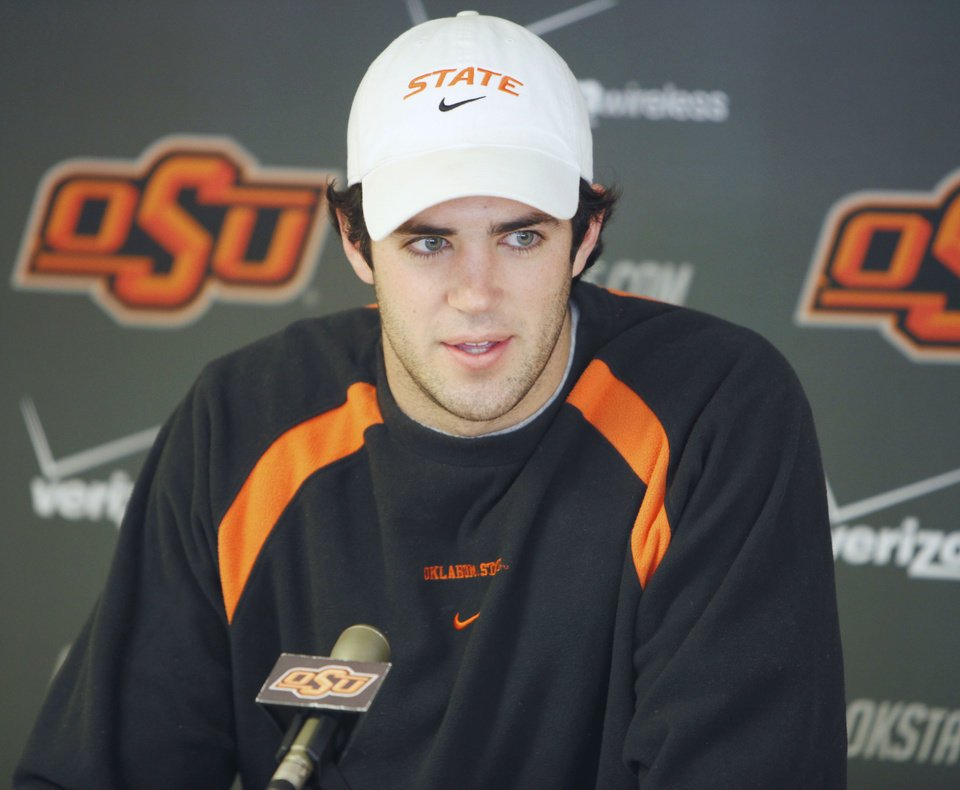 Photo - OKLAHOMA STATE UNIVERSITY / COLLEGE FOOTBALL: Quarterback Zac Robinson speaks to reporters during OSU's pre-bowl game media day at Boone Pickens Stadium in Stillwater, OK, Tuesday, Dec. 15, 2009. By Paul Hellstern, The Oklahoman ORG XMIT: KOD