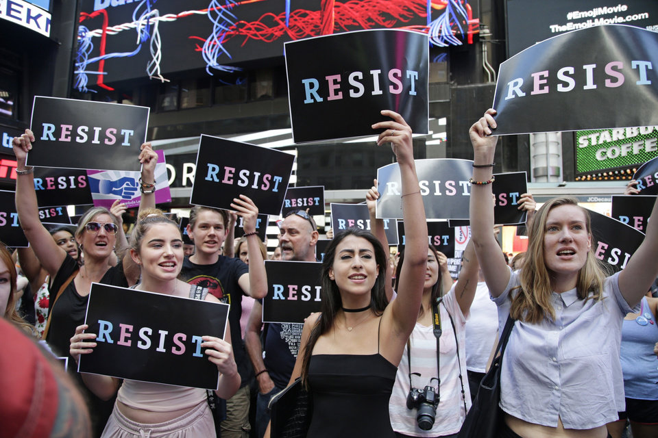 Photo - Protestors gather in Times Square, Wednesday, July 26, 2017, in New York. A rally was held in Times Square after President Donald Trump's announcement of a ban on transgender troops serving anywhere in the U.S. military. (AP Photo/Frank Franklin II)