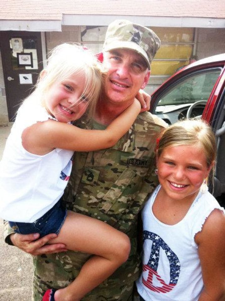 Photo - 1st Sgt. Matt Boyer currently deployed in Afghanistan with daughters Emily, 6, and Abby, 9. Boyer also is an Oklahoma City fireman.  Provided