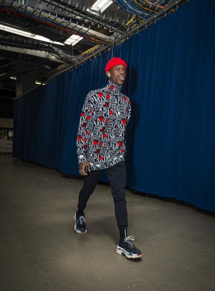 Photo -  Thunder guard Dennis Schroder enters Chesapeake Energy Arena before facing the Lakers on Nov. 22. [Photo courtesy of Zach Beeker/OKC Thunder]
