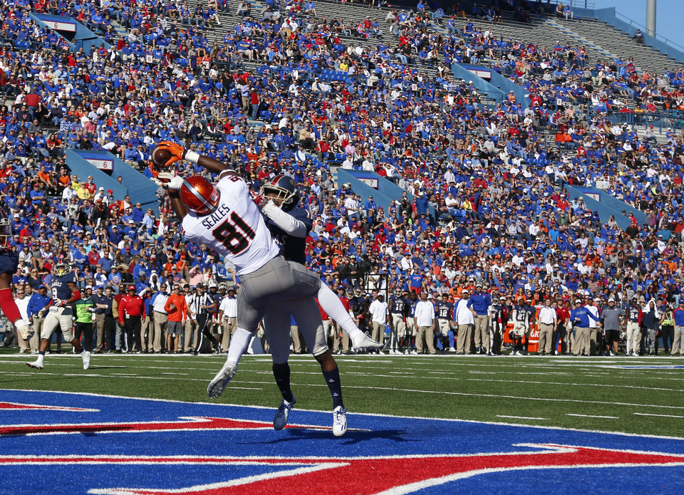 Photo - Oklahoma State's Jhajuan Seales (81) can not hang on to a pass as Kansas's Marnez Ogletree (10) defends in the first quarter during the college football game between the Oklahoma State Cowboys (OSU) and the Kansas Jayhawks at Memorial Stadium in Lawrence, Kan., Saturday, Oct. 22, 2016.   Photo by Sarah Phipps, The Oklahoman