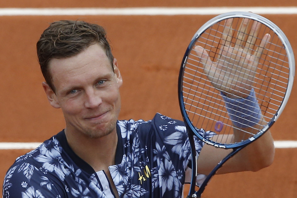 Photo - Tomas Berdych of the Czech Republic celebrates winning the first round match of the French Open tennis tournament against Canada's Peter Polansky at the Roland Garros stadium, in Paris, France, Sunday, May 25, 2014. (AP Photo/Michel Spingler)