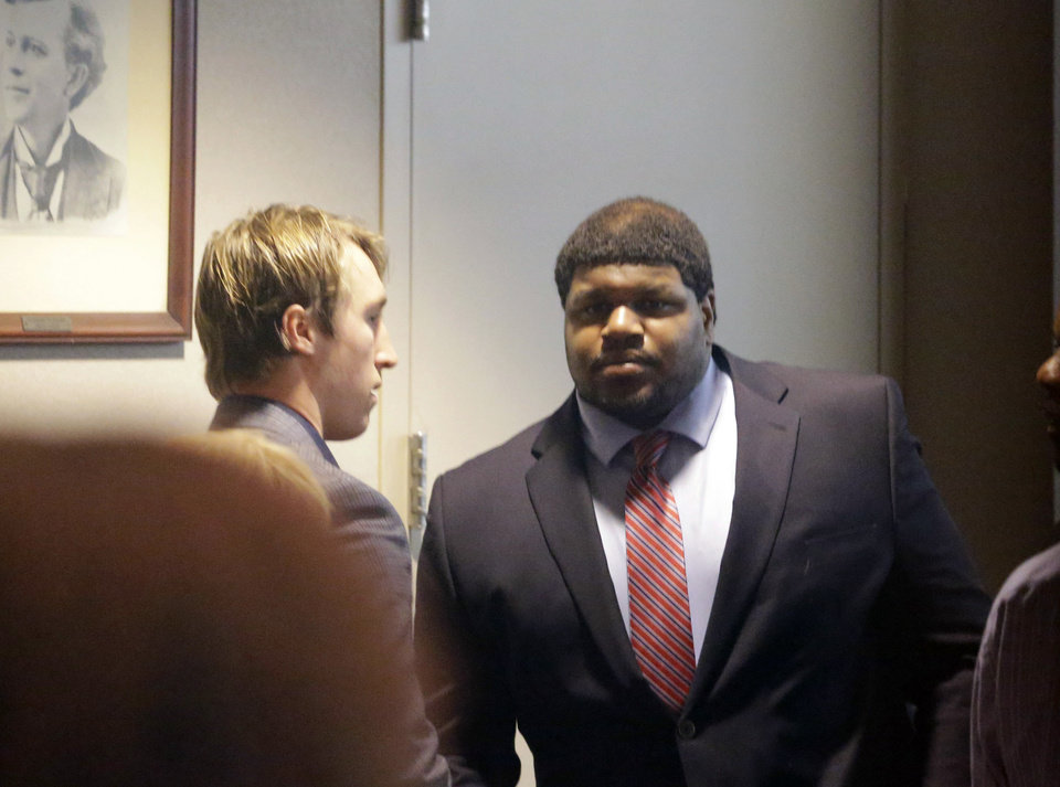 Former Dallas Cowboys NFL football player Josh Brent, right, stands with Dallas Cowboys linebacker Sean Lee in court after closing arguments in his intoxication manslaughter trial Tuesday, Jan. 21, 2014, in Dallas. The jury has begun deliberating in Brent\'s intoxication manslaughter trial after lawyers wrapped up their closing arguments Tuesday morning. Prosecutors accuse the former defensive tackle of drunkenly crashing his Mercedes near Dallas during a night out in December 2012, killing his good friend and teammate, Jerry Brown. (AP Photo/LM Otero)