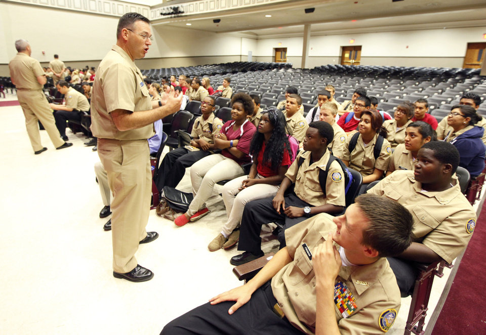 Students listen to Chief of the Boat Joey Hundley, as the crew of USS Oklahoma City submarine meets with the Navy ROTC at Capitol Hill High School on Thursday. PHOTO BY PAUL HELLSTERN, THE OKLAHOMAN <strong>PAUL HELLSTERN - Oklahoman</strong>