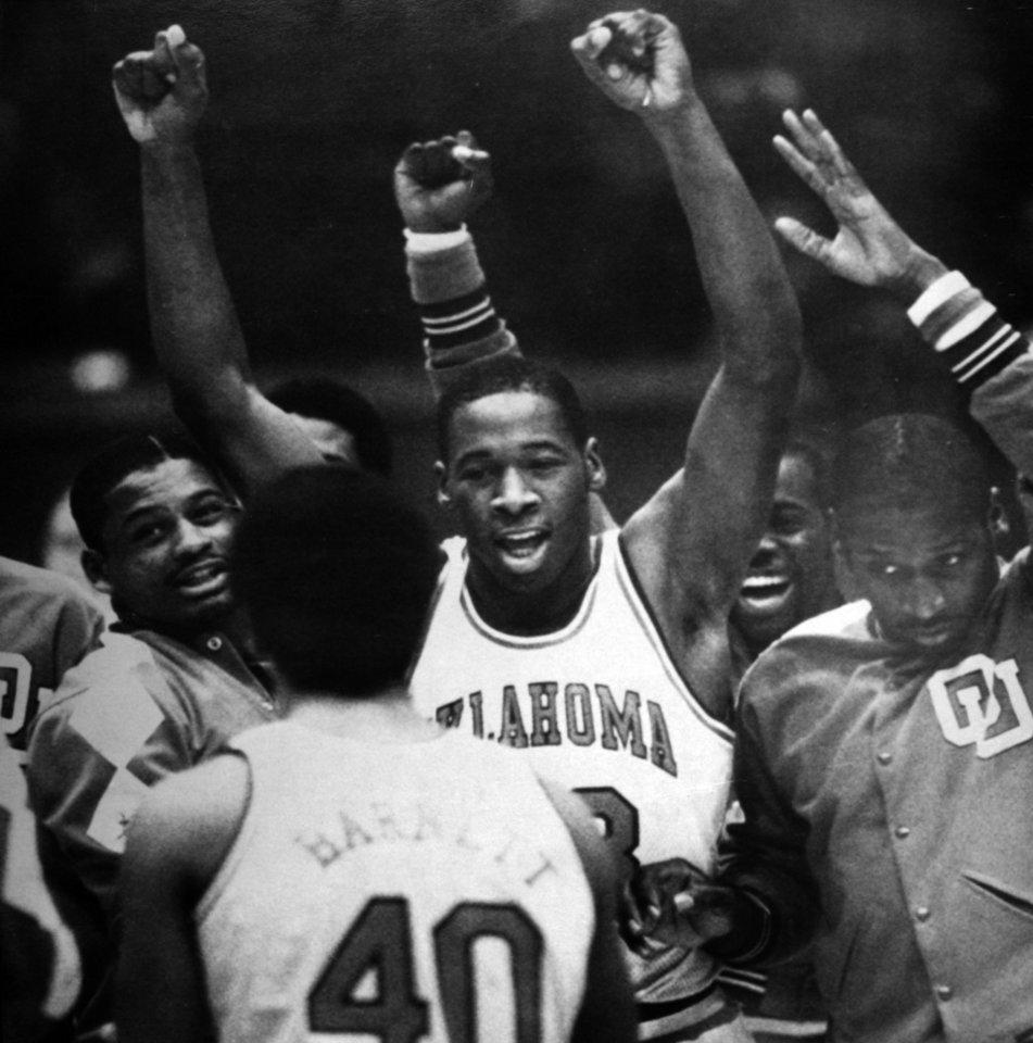 Photo - Former OU basketball player Wayman Tisdale. NORMAN, Okla., March 7--TOURNAMENT CHEER--Oklahoma star freshman Wayman Tisdale, center, leads a cheer on the Sooner basketball team after beating Kansas State on Saturday. His shot with two seconds left won the game, 72-70, and pits Oklahoma against Kansas in the Big Eight tourney. (AP LaserPhoto) 1983. Photo taken 3/7/1983, photo published 3/8/1983 in The Daily Oklahoman. ORG XMIT: KOD