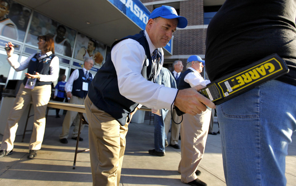 Photo - SMG employee Randy Hampton runs security checks on fans as they enter the arena before game two of the Western Conference semifinals between the Memphis Grizzlies and the Oklahoma City Thunder in the NBA basketball playoffs at Oklahoma City Arena in Oklahoma City, Tuesday, May 3, 2011. Photo by Chris Landsberger, The Oklahoman
