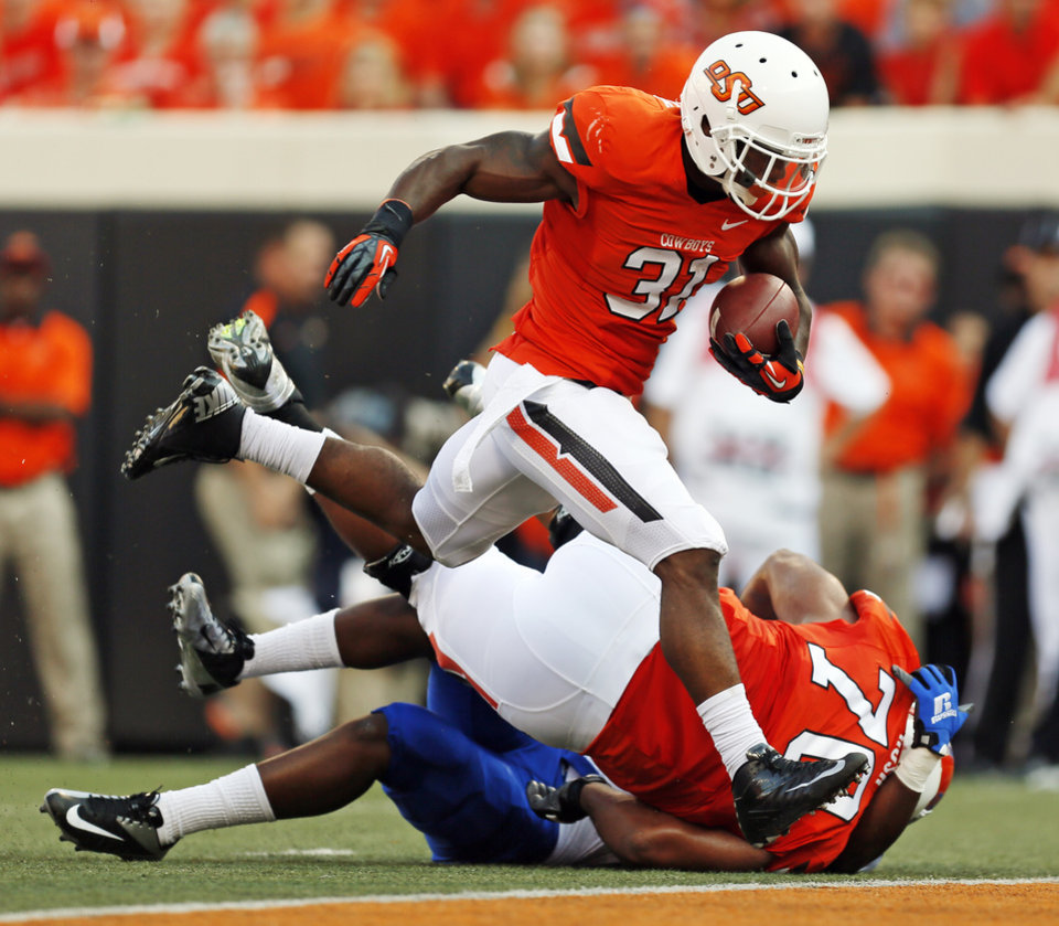 Photo - OSU's Jeremy Smith (31) rushes for a touchdown in the first quarter during a college football game between Oklahoma State University (OSU) and Savannah State University at Boone Pickens Stadium in Stillwater, Okla., Saturday, Sept. 1, 2012. Photo by Nate Billings, The Oklahoman