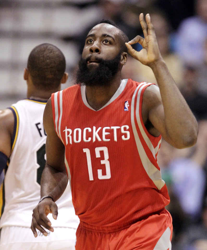 Photo - Houston Rockets' James Harden (13) celebrates his 3-pointer in the third quarter of an NBA basketball game against the Utah Jazz, Monday, Jan. 28, 2013, in Salt Lake City. Harden had 25 points as the Rockets won 125-80. (AP Photo/Rick Bowmer)