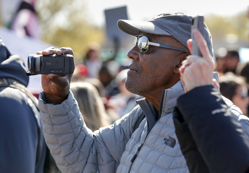 Photo - Carl Albert coach Tex Rollins shoots video of a rally led by students during the third day of a walkout by Oklahoma teachers at the state Capitol in Oklahoma City, Wednesday, April 4, 2018. Photo by Nate Billings, The Oklahoman