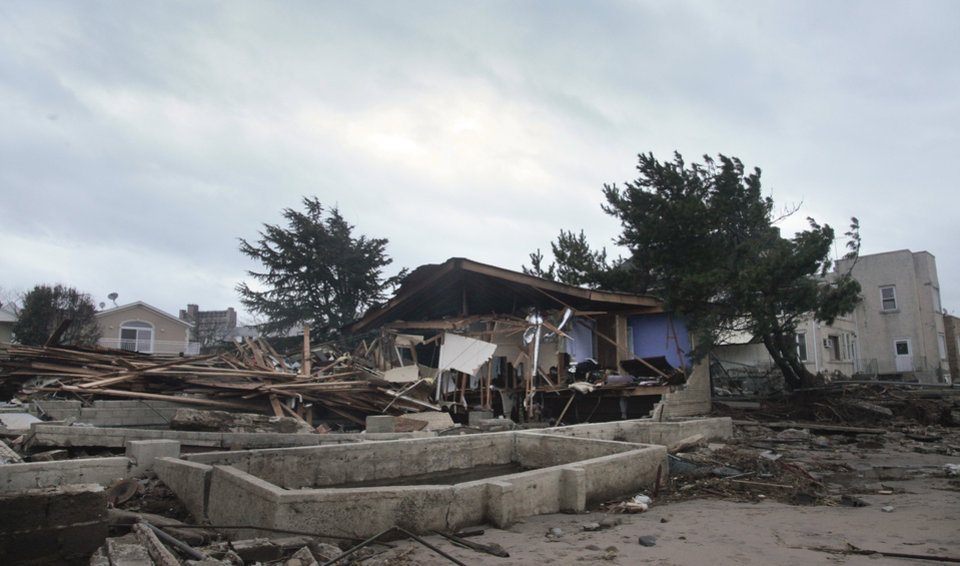A beachfront house is completely destroyed in the aftermath of yesterday's surge from superstorm Sandy, Tuesday, Oct. 30, 2012, in Coney Island's Sea Gate community in New York. (AP Photo/Bebeto Matthews) ORG XMIT: NYBM119