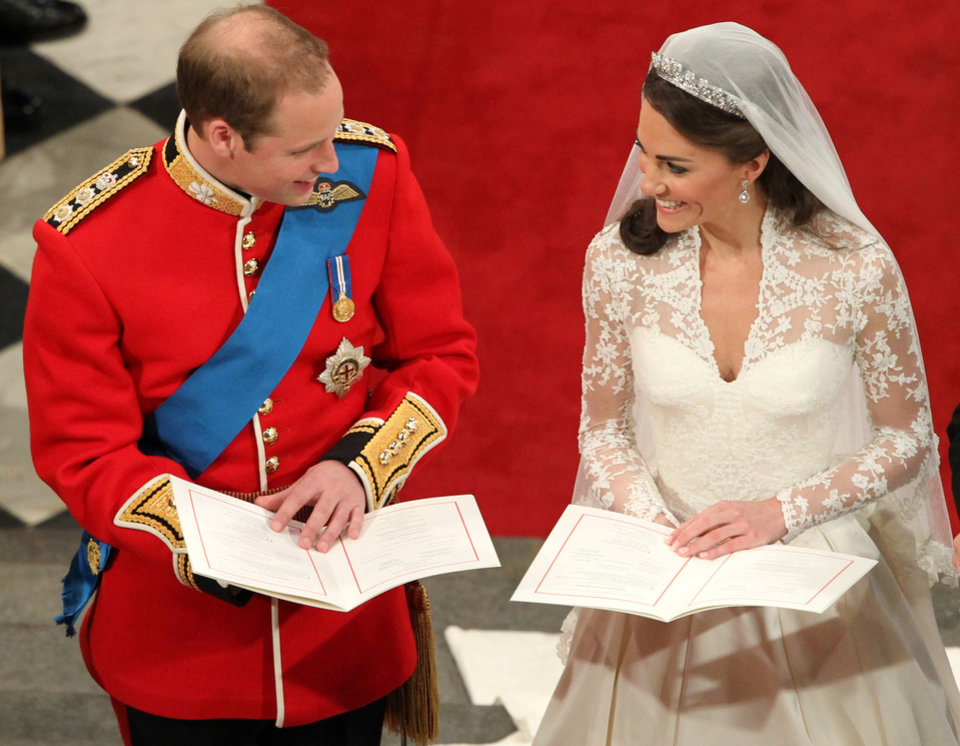 Photo - Britain's Prince William and his bride Kate Middleton during their wedding service at Westminster Abbey, London, Friday April 29, 2011. (AP Photo/Andrew Milligan, Pool) ORG XMIT: RWBJ110