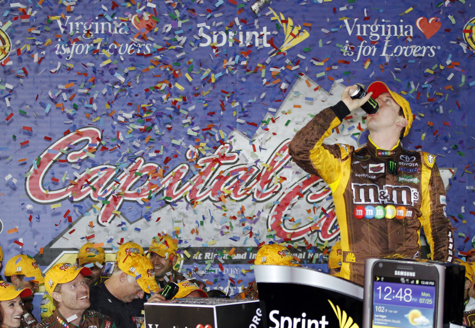 Kyle Busch celebrates winning the NASCAR Sprint Cup Series auto race at Richmond International Raceway in Richmond, Va., Saturday, April 28, 2012. (AP Photo/Steve Helber)