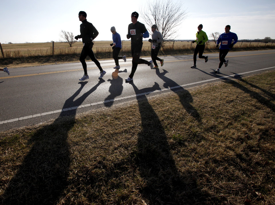 Runners pass the first mile of their 10K run during the annual Deer Creek Classic 5K, 10K, fun runs at Deer Creek High School in Oklahoma City, OK, Saturday, March 5, 2011. By Paul Hellstern, The Oklahoman