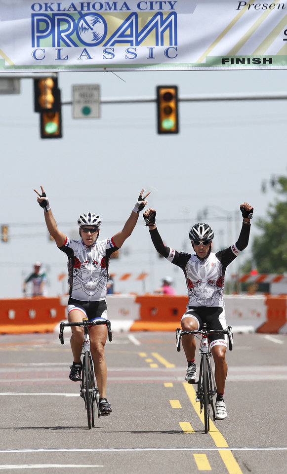 Photo - Teammates John Lasorso and Buster Brown celebrate their first and second place finish in the Masters Men's B event during the  Oklahoma City ProAm Classic, with races scheduled from 11 a.m. to 9 p.m. in Automobile Alley,  just north of downtown Oklahoma City on Saturday, June 2,  2012,   Lasorso and Brown are members of the OKC Velo Club.  Photo by Jim Beckel, The Oklahoman