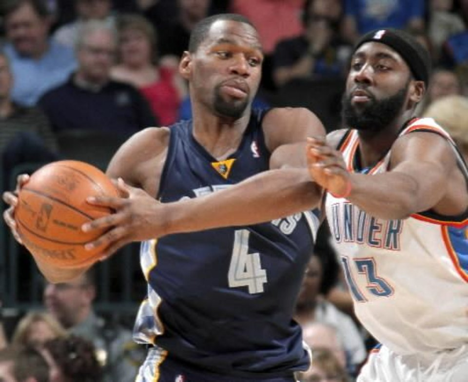 Oklahoma City's James Harden defends Sam Young of  Memphis during the NBA basketball game between the Oklahoma City  Thunder and the  Memphis Grizzlies at the Ford Center in Oklahoma City on Wednesday, April 14, 2010. Photo by Bryan Terry