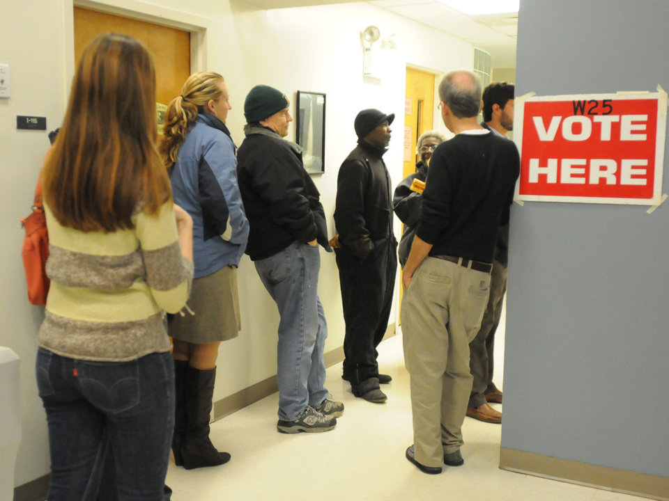 Voters line up outside precinct W25 in Cape Fear Community College's T Building before the polls open Tuesday Nov. 6, 2012 in Wilmington, N.C. (AP Photo/The Star-News, Paul Stephen)