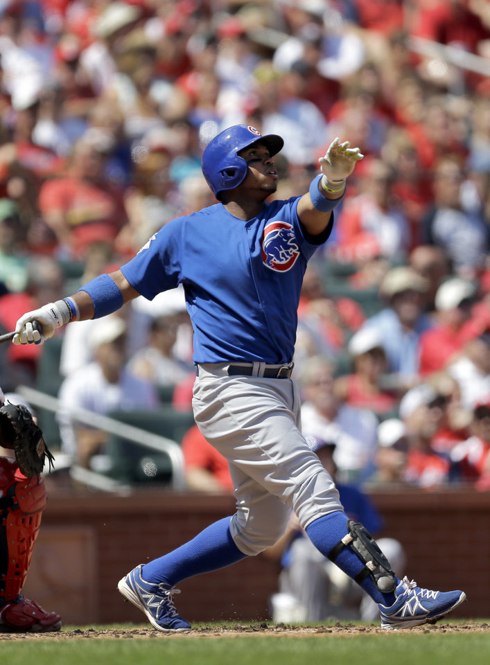 Photo - Chicago Cubs' Luis Valbuena watches his two-run home run during the second inning of a baseball game against the St. Louis Cardinals, Sunday, Aug. 31, 2014, in St. Louis. (AP Photo/Jeff Roberson)