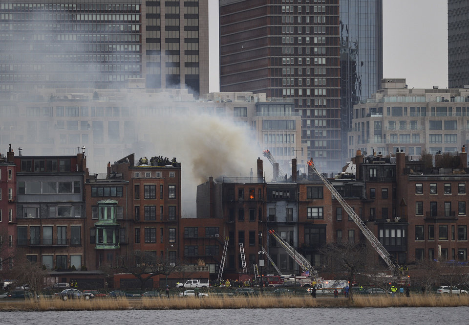 Photo - A multi-alarm blaze at a structure is seen from Cambridge, Mass., as firefighters respond, Wednesday, March 26, 2014. A Boston city councilor said two firefighters have died in a fire that ripped through a brownstone. (AP Photo/The Boston Globe, Essdras M Suarez) BOSTON HERALD OUT, QUINCY OUT; NO SALES