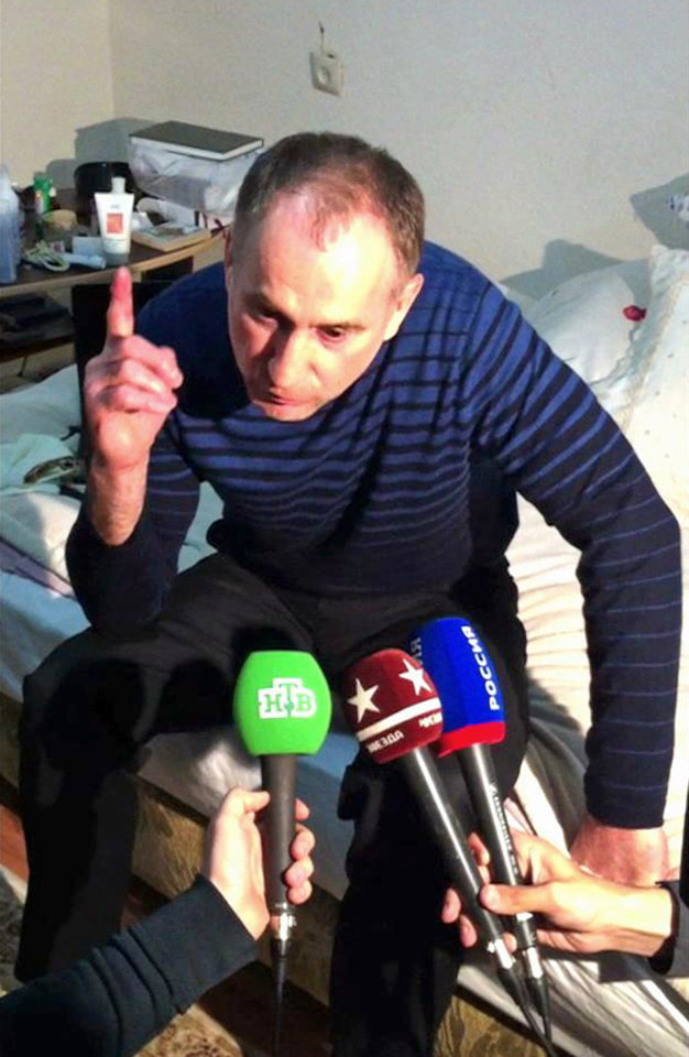 Photo - In this image taken from a mobile phone video, the father of USA Boston bomb suspects, Anzor Tsaraev reacts as he talks to the media about his sons, in his home in the Russian city of Makhachkala, Friday April 19, 2013.  One son is now dead, and one son Dzhokhar Tsaraev is still at large on Friday suspected in Monday's deadly Boston Marathon bombing which stunned friends who have pleaded for the surviving brother, described as bright and outgoing young man, to turn himself in and not hurt anyone.(AP Photo)
