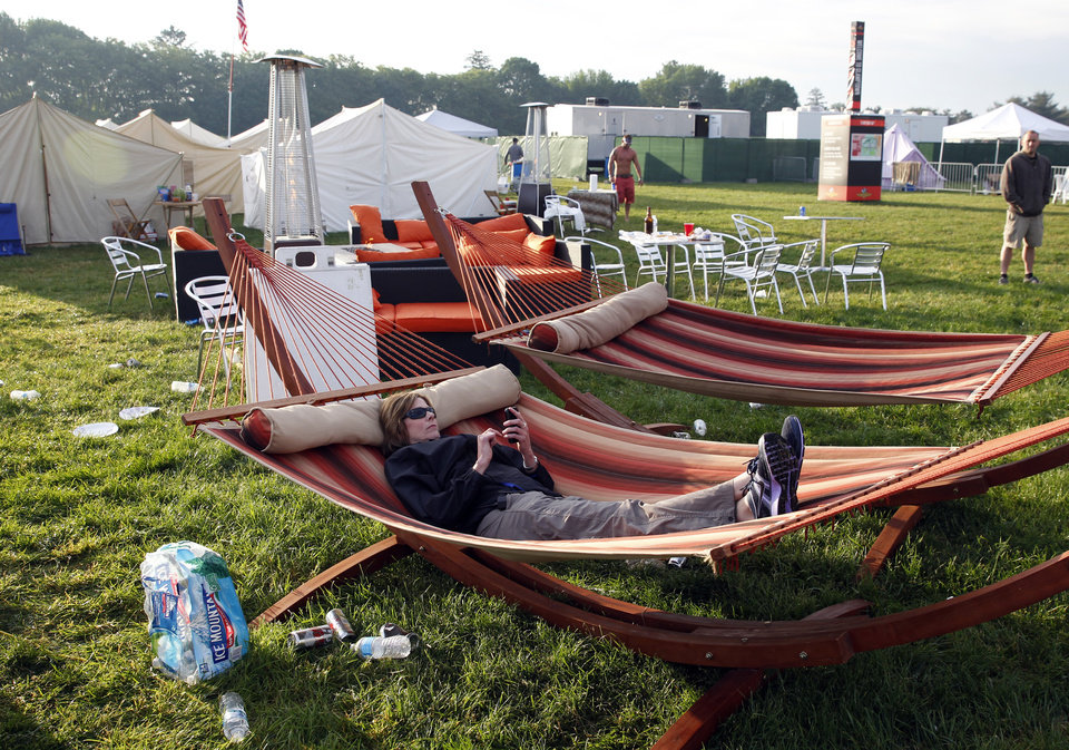 Photo - Mary Milz, of Indianapolis, lies in a hammock, in the