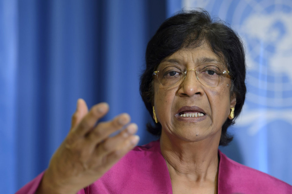 Photo - UN High Commissioner for Human Rights, South African Navi Pillay, answers journalist's questions about the human rights situation in the world, during a press conference at the Geneva Press Club, in Geneva, Switzerland, Thursday, July 31, 2014. (AP Photo/Keystone, Martial Trezzini)