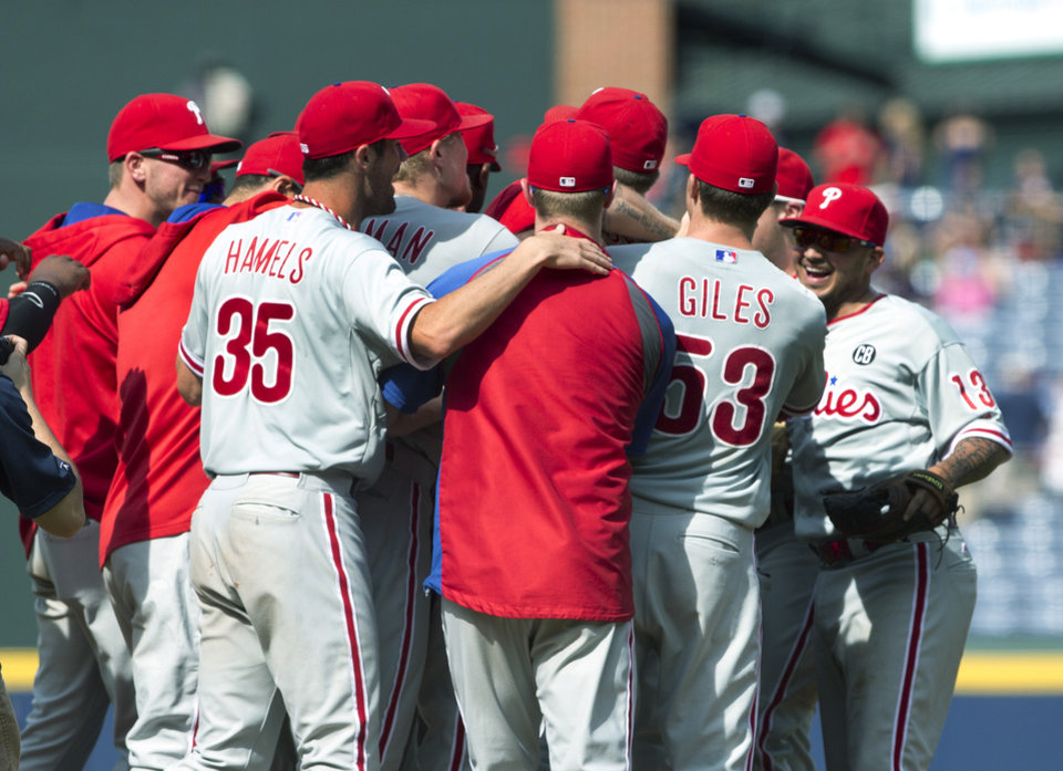 Photo - The Philadelphia Phillies celebrate after a combined no-hit 7-0 win over the Atlanta Braves in a baseball game Monday, Sept. 1, 2014, in Atlanta. Cole Hamels,  and relief pitchers Ken Giles,  Jonathan Papelbon and Jake Diekman combined for the no hitter. (AP Photo/John Bazemore)
