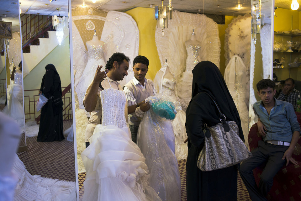Photo - Yemeni women shop for wedding dresses in Sanaa, Yemen, Wednesday, Dec. 26, 2012. While most Yemeni women don the traditional niqab, gender separated weddings bring out the latest in western-style wedding dresses. (AP Photo/Alex Potter)