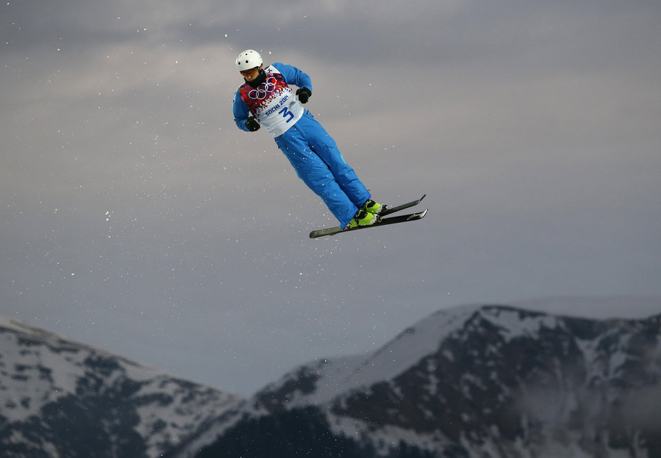 Photo - Anton Kushnir of Belarus jumps during men's freestyle skiing aerials qualifying at the Rosa Khutor Extreme Park, at the 2014 Winter Olympics, Monday, Feb. 17, 2014, in Krasnaya Polyana, Russia.(AP Photo/Sergei Grits)