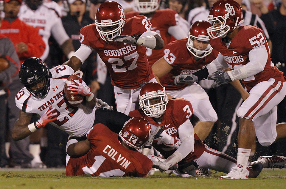 The Sooner defense brings down Texas Tech's Ben McRoy (23) during the college football game between the University of Oklahoma Sooners (OU) and Texas Tech University Red Raiders (TTU) at the Gaylord Family-Oklahoma Memorial Stadium on Saturday, Oct. 22, 2011. in Norman, Okla. Photo by Chris Landsberger, The Oklahoman
