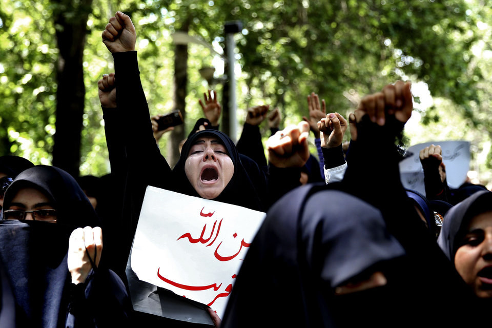 Photo - Iranian and Syrian students chant slogans during an anti-Israeli demonstration in front of the UN office in Tehran, Iran, Monday, May 6, 2013. Iran Condemns Israeli Air strikes on Syria and urged countries in the region to stand against the attack. (AP Photo/Ebrahim Noroozi)