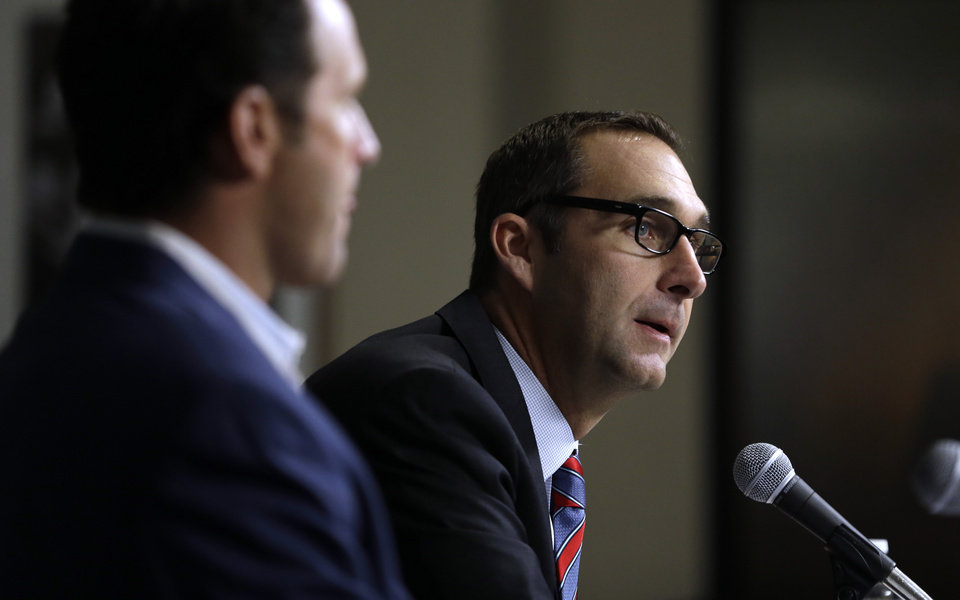 St. Louis Cardinals general manager John Mozeliak, right, and manager Mike Matheny discuss the future of Cardinals pitcher Chris Carpenter during a baseball news conference Tuesday, Feb. 5, 2013, in St. Louis. The Cardinals announced Carpenter will not pitch in the 2013 season and his future with the team is uncertain due to a lingering injury. (AP Photo/Jeff Roberson)