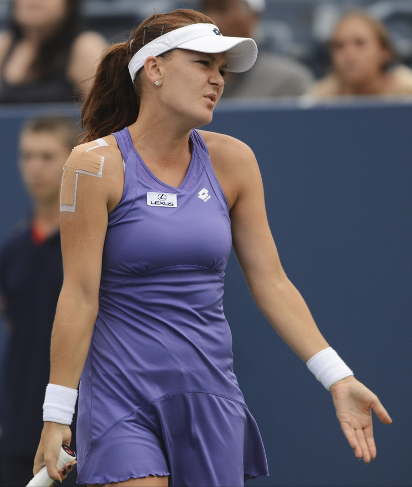 Photo -   Agnieszka Radwanska, of Poland, reacts during her match against Italy's Roberta Vinci in the fourth round of play at the 2012 US Open tennis tournament, Monday, Sept. 3, 2012, in New York. Radwanska lost the match. (AP Photo/Henny Ray Abrams)