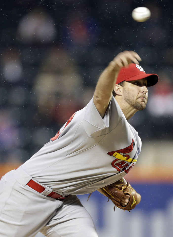 Photo - St. Louis Cardinals' Adam Wainwright  delivers a pitch during the first inning of a baseball game against the New York Mets Tuesday, April 22, 2014, in New York. (AP Photo/Frank Franklin II)