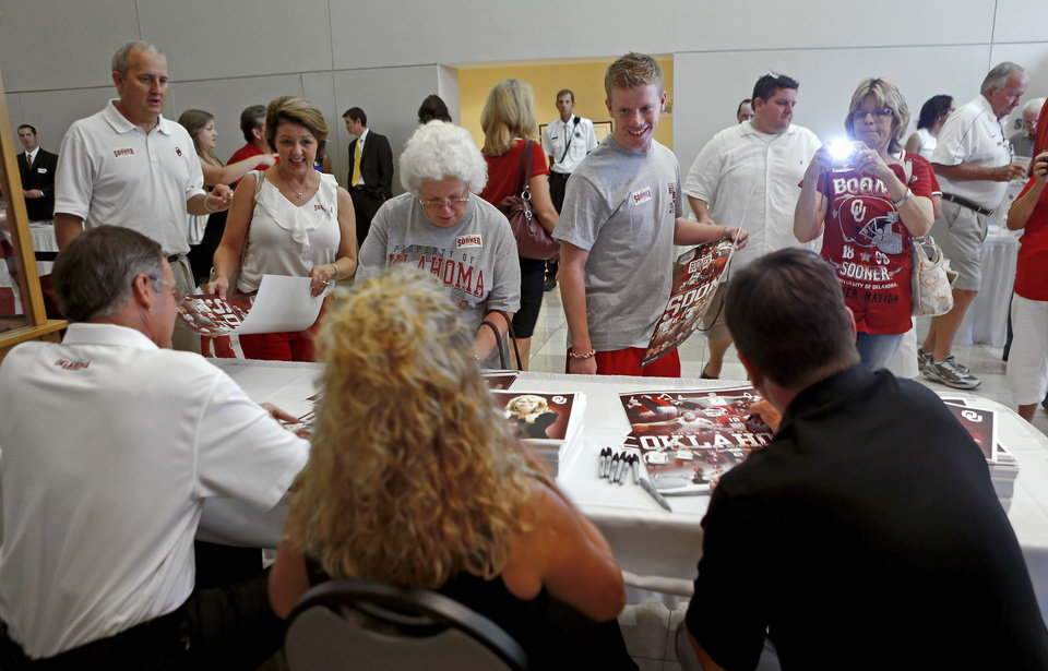 Oklahoma football coach Bob Stoops, right, women's basketball coach Sherri Coale, and men's basketball coach Lon Kruger greet fans during the Sooner Caravan stop at the National Cowboy & Western Heritage Museum  in Oklahoma City, Wednesday, August 1, 2012. Photo by Bryan Terry, The Oklahoman